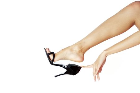 Woman hand and leg in black shoe against white background Stock Photo - 4891912