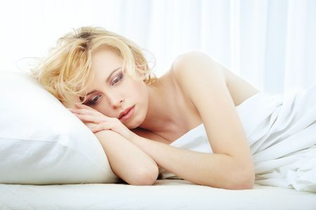 enamored: Sad enamored lady laying in the bedroom  Stock Photo