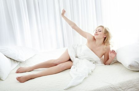 Woman feeling good at the morning in her bedroom photo