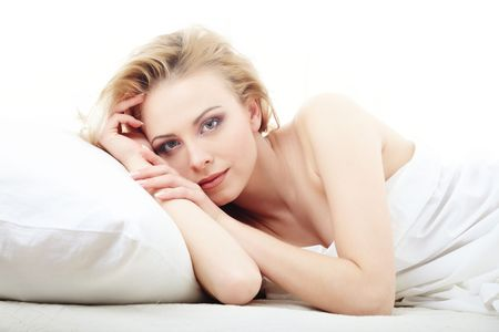 bedstead: Resting lady laying on the bed on a white background