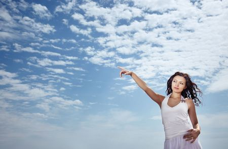 Lady pointing her finger at the sky Stock Photo - 5212154