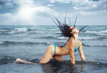 Sexy lady in bikini at the summer beach Stock Photo - 5212158