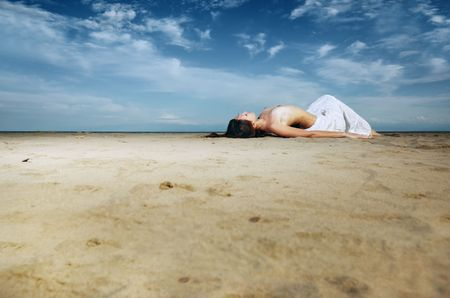 Topless lady laying on the sand at the beach Stock Photo - 5212160