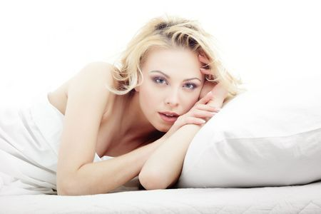 bedlinen: Sexy lady laying on the bed