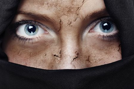 Face with damaged skin covered by headscarf photo