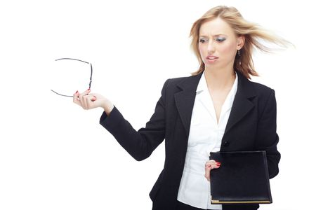 Angry businesswoman with hairs blown by wind Stock Photo - 5411736