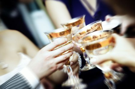 clang: Close-up photo of human hands clangin wineglasses and celebrating event