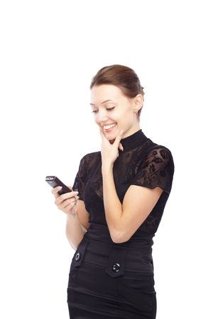 Joyful lady holding cell phone and sending SMS photo