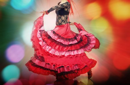spanish dancer: Woman dancing flamenco on background with disco illumination