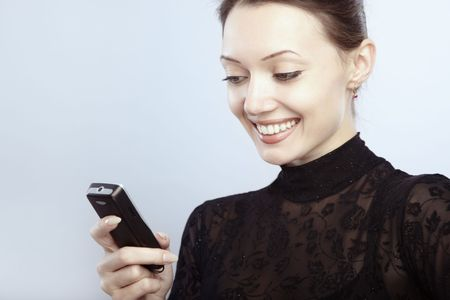 Smiling lady reading or sending SMS  photo