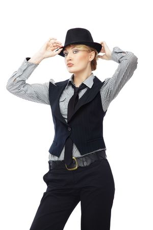 Sexy lady in stylish business clothes adjusting black hat photo