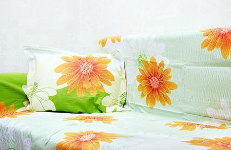 bedclothes: Sofa indoors with colorful bed-clothes