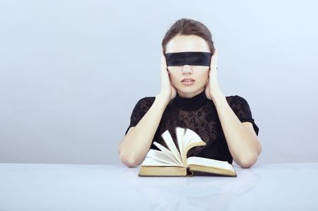 recite: Lady with blindfold hearing the book pages.  Stock Photo