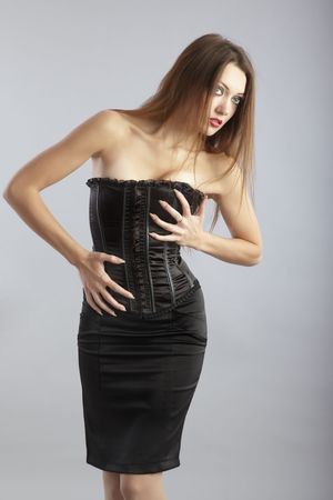 nifty: Nifty model with perfect figure in stylish corset Stock Photo