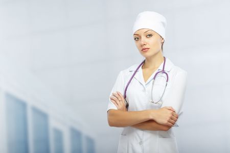Cross-armed doctor with stethoscope in clinic. Healthcare theme Stock Photo - 5964744