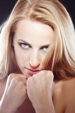 pugilist: Beautiful lady with clinched fists protecting herself as a symbol of womans right