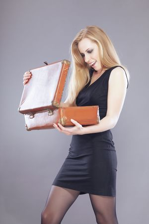 Happy surprising lady opening case with wealth Stock Photo - 6156406