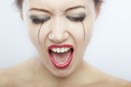 Close-up portrait of the crying and screaming lady with painted tears Stock Photo - 6227329