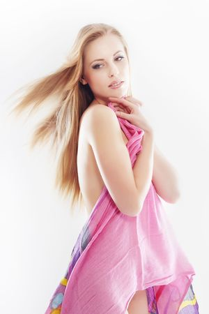 Elegant blond lady on a white background with colorful cloth photo