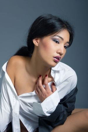 Vertical photo of the beautiful Asian lady in the shirt with naked shoulder photo