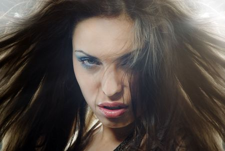 Close-up portrait of the angry horrible female witch with blown hairs Stock Photo - 6527105