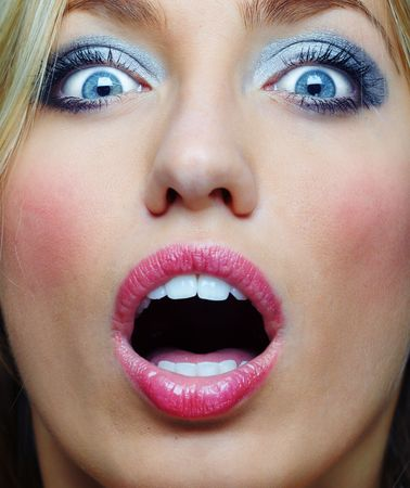 outcry: Close-up portrait of the surprised lady with good makeup screaming. Vibrant colors