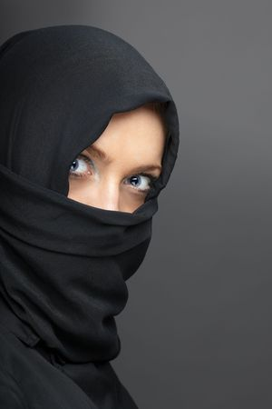 Ninja in special black costume on a gray background Stock Photo - 7109698