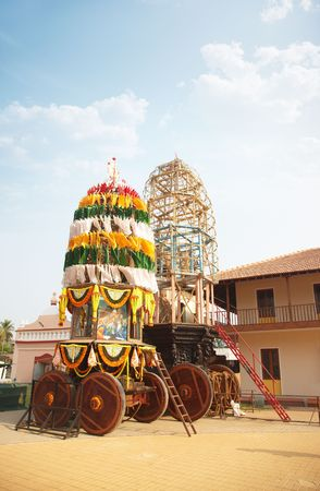 Traditional holly chariot with wooden wheels in the Indian religious temple. Preparation for Vishnu festival. India, Goa photo