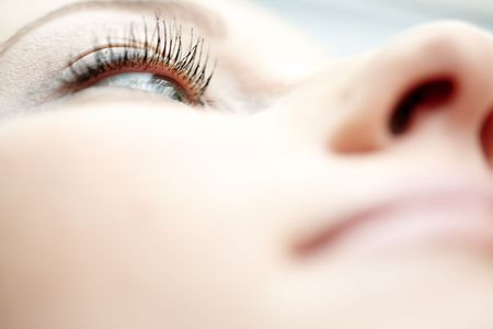 woman eye. Shallow depth of field due to the macro lens for purity effect photo