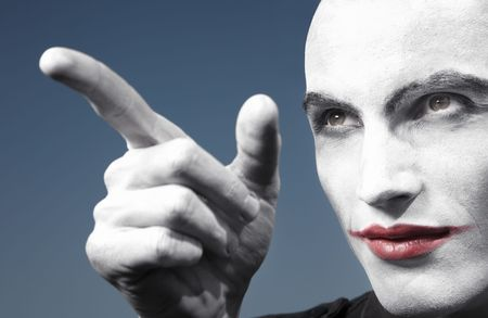 Agnry clown outdoors pointing finger. Horizontal photo photo