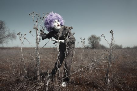 periwig: Crazy funny man outdoors in the steppe. Artistic colors added