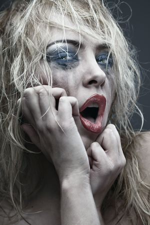 Crazy lady with odd and grungy makeup. Vertical photo. Artistic colors and darkness added Stock Photo - 7564812
