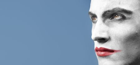 malefactor: Face-painted man outdoors. Horizontal close-up photo with empty space