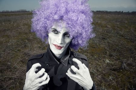 Crazy clown outdoors waiting his victim. Artistic colors added Stock Photo - 7954513