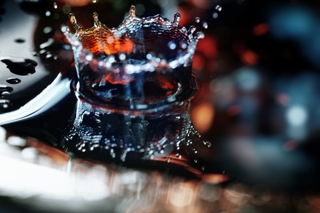 splutter: Extremely macro photo of the liquid drop falling on a wet colorful surface