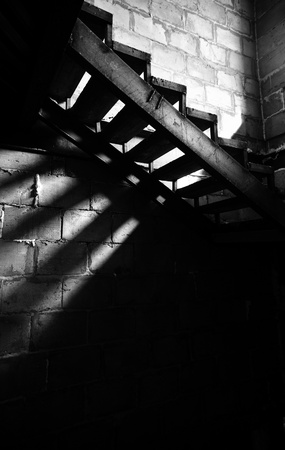 olden: Metal old staircase in the abandoned building. Natural light and shadows Stock Photo