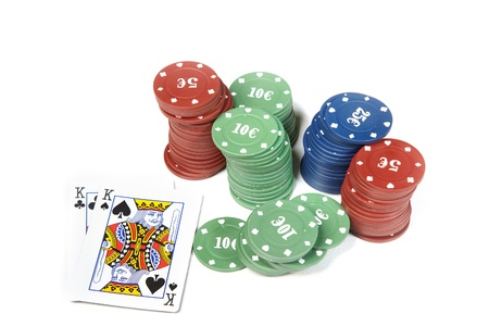 boodle: Pair of kings and poker chips on a white table