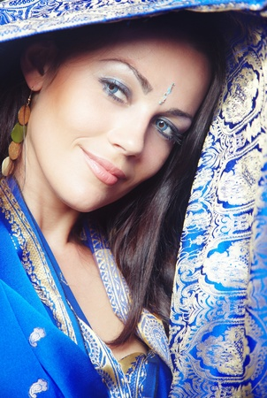 Elegant smiling lady in stylish blue wedding sari. Natural colors. Vertical photo photo
