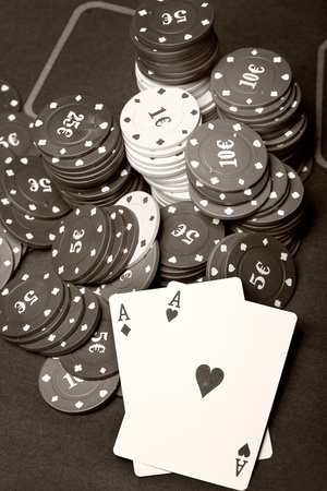 vehemence: Old poker cards and chips. Sepia toned