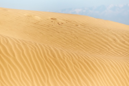 View on the rippled sand dunes in the desert. Natural light and colors photo