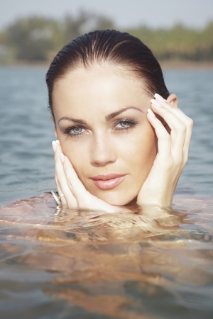 Headshot of the woman in the water of the summer beach