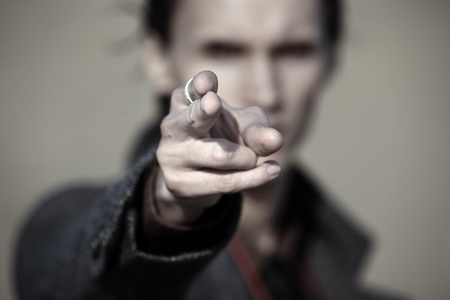 fingertip: Close-up photo of the criminal man pointing finger. Focus on the fingertip