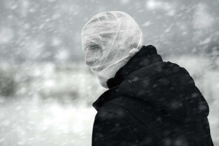 Anonymous person with bandaged head under the nuclear snowstorm Stock Photo - 10024038