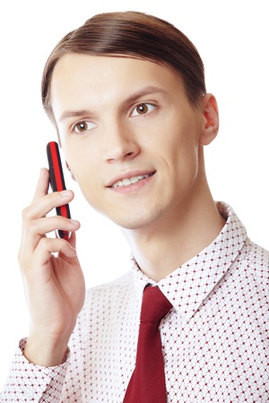 Smiling businessman talking via cell phone on a white background Stock Photo - 10281994