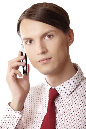 Successful businessman talking via cell phone on a white background Stock Photo - 10450978