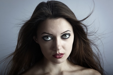 gothic woman: Portrait of the woman with Gothic makeup and blown hairs