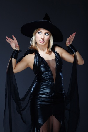 necromancer: Pretty lady in the witch costume on a dark background Stock Photo