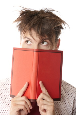 cogitate: Crazy student holding red book on a white background