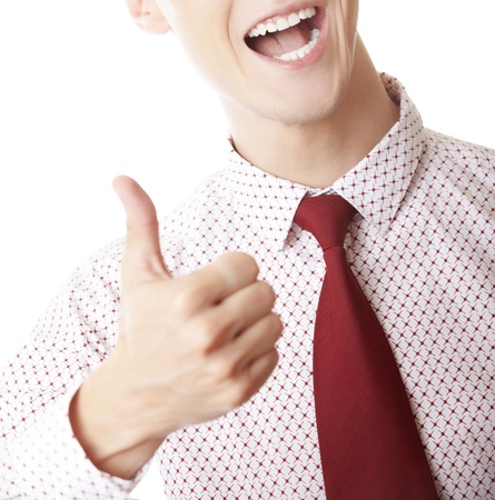 Successful unrecognizable businessman making thumbs up gesture photo