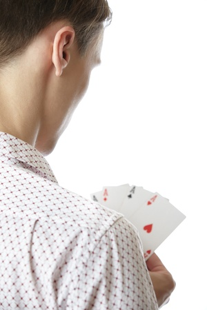 Man holding cards with Four of Aces. Rear view on a white background photo